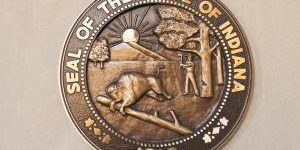 The Seal of the State of Indiana in bronze cast hangs on a wall. Indiana will be celebrating its bicentennial in 2016.